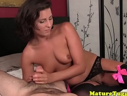 Mature in lingerie giving tugjob