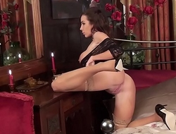 Beautiful brunette Milf Nina Leigh arrives to entertain you in her tan stockings