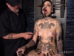 Inked slave in bondage chair whipped